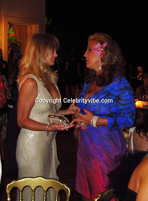 Goldie Hawn and Denise Rich..De Grisogno Party..2011 Cannes Film Festival..Eden Roc Restaurant at Hotel Du Cap..Cap D'Antibes, France..Tuesday, May 17, 2011..Photo By CelebrityVibe.com..To license this image please call (212) 410 5354; or.Email: CelebrityVibe@gmail.com ;.website: www.CelebrityVibe.com