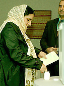 McLean, VA - December 13, 2005 -- Fatima Youssif, who emigrated to Binghamton, New York from Duhua, Iraq to escape being gassed by Saddam Hussein, dips her finger in a vial of purple ink before casting her ballot in the Iraqi election in McLean, Virginia on December 13, 2005. .Credit: Ron Sachs / CNP.(RESTRICTION: NO New York or New Jersey Newspapers or newspapers within a 75 mile radius of New York City)