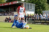 EMMEN - Voetbal, VV Emmen - FC Emmen, voorbereiding seizoen 2018-2019, 07-07-2018,  FC Emmen speler Caner Cavlan ontwijkt een tackle van Patrick Eberhard
