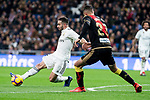 Dani Carvajal of Real Madrid and Santi Comesana of Rayo Vallecano during La Liga match between Real Madrid and Rayo Vallecano at Santiago Bernabeu Stadium in Madrid, Spain. December 15, 2018. (ALTERPHOTOS/Borja B.Hojas)