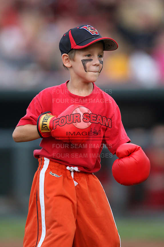 A young fan wearing a Washington Wizards hat and Bryce Harper style face paint participates in an on-field promotion during a game between the Erie Seawolves and Harrisburg Senators at Jerry Uht Park on August 6, 2011 in Erie, Pennsylvania.  Harrisburg defeated Erie 10-6.  (Mike Janes/Four Seam Images)