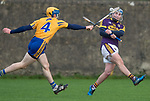 Seadna  Morey of Clare in action against Seamus Casey of Wexford during the Jack Lynch Memorial game at Tulla. Photograph by John Kelly.