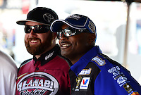 Sept. 28, 2012; Madison, IL, USA: NHRA top fuel dragster drivers Antron Brown (right) and Shawn Langdon during qualifying for the Midwest Nationals at Gateway Motorsports Park. Mandatory Credit: Mark J. Rebilas-
