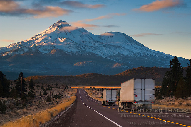 Mount Shasta and semi-tractor trailer trucks on  rural highway, Siskiyou County, California