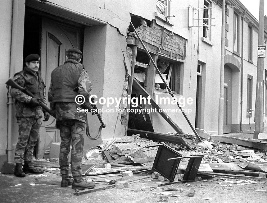 British soldiers at the scene of the New Year's Eve explosion in which 2 men and one woman died in the Central Bar, Gilford, Co Armagh, N Ireland. The bomb was planted by the INLA, Irish National LIberatation Army. 19760101005b..Copyright Image from Victor Patterson, 54 Dorchester Park, Belfast, United Kingdom, UK...For my Terms and Conditions of Use go to http://www.victorpatterson.com/Victor_Patterson/Terms_%26_Conditions.html