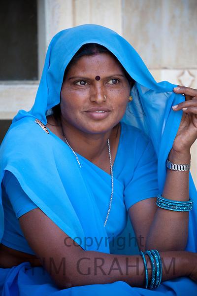 Indian Hindu woman in traditional Rajasthani sari at The Amber Fort in Jaipur, Rajasthan, India