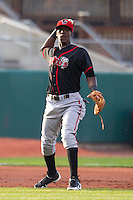 Lansing Lugnuts third baseman Gustavo Pierre #17 throws during a game against the Cedar Rapids Kernels at Veterans Memorial Stadium on April 29, 2013 in Cedar Rapids, Iowa. (Brace Hemmelgarn/Four Seam Images)
