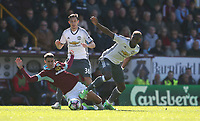 Burnley's Matthew Lowton is fouled by Manchester United's Paul Pogba<br /> <br /> Photographer Stephen White/CameraSport<br /> <br /> The Premier League - Burnley v Manchester United - Sunday 23rd April 2017 - Turf Moor - Burnley<br /> <br /> World Copyright &copy; 2017 CameraSport. All rights reserved. 43 Linden Ave. Countesthorpe. Leicester. England. LE8 5PG - Tel: +44 (0) 116 277 4147 - admin@camerasport.com - www.camerasport.com
