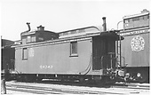 Side-end angle view of long caboose #04343, round herald, two side windows, &quot;square box&quot; lantern on cupola, off-set stove pipe.<br /> D&amp;RGW  Alamosa, CO  Taken by Perry, Otto C.