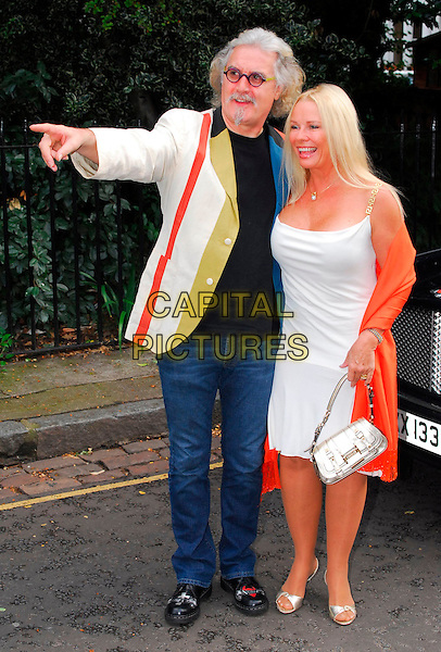 BILLY CONNOLLY & PAMELA STEPHENSON.Sir David Frost Summer Party, Carlyle Square, London, UK..July 5th, 2006.Ref: CAN.full length silver purse bag shoes red orange pashmina jeans denim jacket white dress husband wife married pointing.www.capitalpictures.com.sales@capitalpictures.com.©Capital Pictures