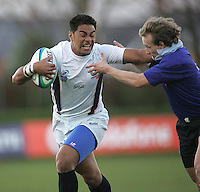USA centre Hoseki Kofe fends-off Russian winger Alexey Andreev during the IRB U19 World Championship Division B first round match played at Gibson Park, Belfast. Result Russia 0 USA 6.