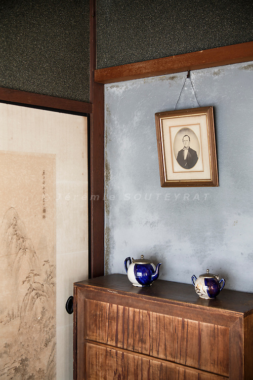 Hino, Shiga prefecture, October 6 2013 - A portrait of Mr Moore's ancesotor lies next to a traditional japanese sliding door in the 150-year-old traditional house renovated by Mr Austin Moore and his wife.