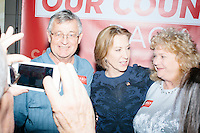 Richard and Deborah Helman, of Martinsburg, West Virginia, pose for a picture with Republican presidential candidate Carly Fiorina as she greets people after speaking at a town hall campaign event at LaBelle Winery in Amherst, New Hampshire.