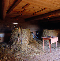 Bales of hay in the interior of a working barn