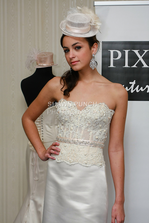 Model poses in a Valeria wedding dress by Kimberly Pixton Millar, for the Pixton Couture Bridal Spring 2011 presentation during the WeddingChannel Couture Show, October 18, 2010.