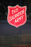 The Salvation Army sign on glass <br /> window