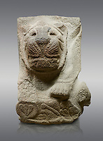 Alaca Hoyuk - Hittite lion sculpture corner Stone . Andesite. Alacahoyuk, 1399 - 1301 B.C. Anatolian Civilisations Museum, Ankara, Turkey.<br /> <br /> Corner stone with sculpted lion, bull and winged sun disk. It was discovered at the right side of the Alacahoyuk sphinx door. The lion puts his front legs on a small bull. There is a Hittite winged sun disk on the abdomen of the lion, which can be seen from a lower location. The position of the sun course indicates that the stone is situated in a high place.<br /> Against a grey background.
