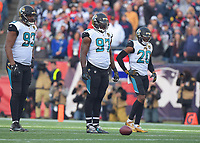 Jacksonville Jaguars Calais Campbell (93), Malik Jackson (97) and Jalen Ramsey (20) against the New England Patriots in the AFC Championship game Sunday, January 21, 2018 in Foxboro, MA.  (Rick Wilson/Jacksonville Jaguars)