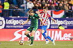 Darko Brasanac (l) of Real Betis Balompie battles for the ball with Gabriel Fernandez Arenas 'Gabi' of Atletico de Madrid during their La Liga 2016-17 match between Atletico de Madrid vs Real Betis Balompie at the Vicente Calderon Stadium on 14 January 2017 in Madrid, Spain. Photo by Diego Gonzalez Souto / Power Sport Images