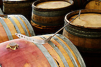 wooden bung with jute on barrel, batonnage tool domaine gachot-monot nuits-st-georges cote de nuits burgundy france
