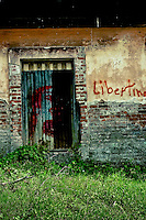 costa rica, central america, abandoned, graffiti, outskirts, city, town, signs, buildings