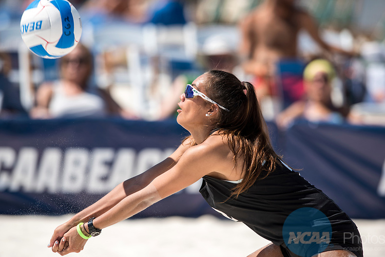 GULF SHORES, AL - MAY 07: Ka'iwi Schucht of the University of Hawaii returns a serve against Pepperdine University during the Division I Women's Beach Volleyball Championship held at Gulf Place on May 7, 2017 in Gulf Shores, Alabama. Pepperdine defeated Hawaii 3-0 to advance to the championship game.  (Photo by Stephen Nowland/NCAA Photos via Getty Images)