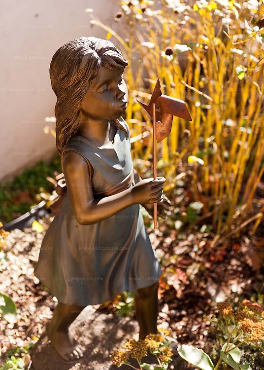 A small statue picks up the morning light, in the garden outside the tasting room at Miracle Valley Vineyard.