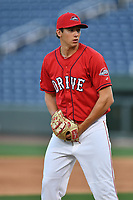 Pitcher Pat Goetze (12) of the Greenville Drive at the team's first workout of the season on Tuesday, April 4, 2017, at Fluor Field at the West End in Greenville, South Carolina. (Tom Priddy/Four Seam Images)