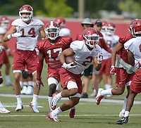 NWA Democrat-Gazette/ANDY SHUPE<br /> Arkansas running back Chase Hayden (2) carries the ball Tuesday, Aug. 7, 2018, during practice at the university practice fields in Fayetteville. Visit nwadg.com/photos to see more photographs from the practice.