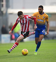 Lincoln City's Shay McCartan vies for possession with Mansfield Town's CJ Hamilton<br /> <br /> Photographer Chris Vaughan/CameraSport<br /> <br /> The EFL Sky Bet League Two - Lincoln City v Mansfield Town - Saturday 24th November 2018 - Sincil Bank - Lincoln<br /> <br /> World Copyright &copy; 2018 CameraSport. All rights reserved. 43 Linden Ave. Countesthorpe. Leicester. England. LE8 5PG - Tel: +44 (0) 116 277 4147 - admin@camerasport.com - www.camerasport.com