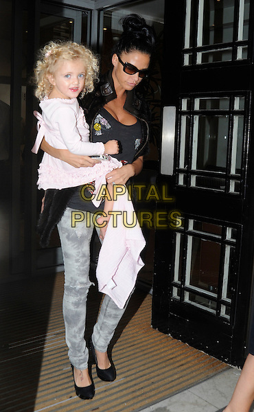PRINCESS TIAAMII ANDRE & KATIE PRICE (JORDAN) .Seen leaving BBC Radio 2 building in central London, England, UK, .July 22nd 2010..full length carrying daughter mother kid child family mom mum black top pink jeans grey gray tie dye denim shoes heels sunglasses jacket holding blanket dress .CAP/IA.©Ian Allis/Capital Pictures.