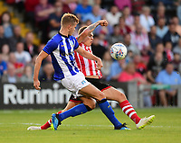 Lincoln City's Harry Anderson vies for possession with Sheffield Wednesday's Joost Van Aken<br /> <br /> Photographer Chris Vaughan/CameraSport<br /> <br /> Football Pre-Season Friendly - Lincoln City v Sheffield Wednesday - Friday 13th July 2018 - Sincil Bank - Lincoln<br /> <br /> World Copyright &copy; 2018 CameraSport. All rights reserved. 43 Linden Ave. Countesthorpe. Leicester. England. LE8 5PG - Tel: +44 (0) 116 277 4147 - admin@camerasport.com - www.camerasport.com