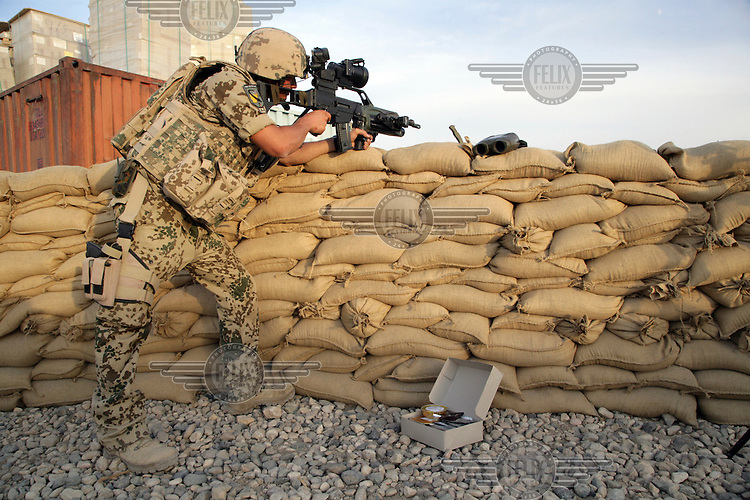 A soldier from the Bundeswehr (unified armed forces of Germany) deployed as part of the ISAF Quick Reaction Force in Mazar-e-Sharif. ISAF (the International Security Assistance Force) is a peacekeeping mission affiliated to the United Nations (UN) and NATO.