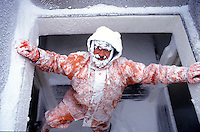 "Dennis Scholl pears out of the fish hold after he iced it on the cod fishing boat ""Sea Spider"" in Dutch Harbor, Alaska in 1993.  This boat supplies cod which is used as bait to the crab fishermen in the Bering Sea.  The Bering Sea is known for having the worst storms in the world. Crab fishing in the Bering Sea is considered to be one of the most dangerous jobs in the world.  This fishery is managed by the Alaska Department of Fish and Game and is a sustainable fishery.  The Discovery Channel produced a TV series called ""The Deadliest Catch"" which popularized this fishery."