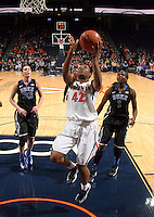 Virginia forward Sarah Imovbioh (42) shoots in front of Duke defenders during an NCAA college basketball game in Charlottesville, Va. Duke defeated Virginia 62-41...