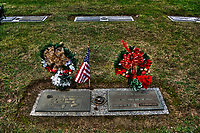 Markers on grave of World War II veteran at a Westerville, Ohio, cemetery on Pearl Harbor Day, Dec. 7, 2011.