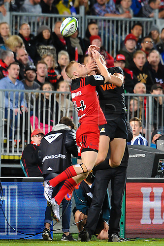15.04.2016. Christchurch, New Zealand.  Johnny McNicholl of the Crusaders Emiliano Boffelli of the Jaguares go for a high ball during the Super Rugby Match, Crusaders V Jaguares, AMI Stadium, Christchurch, New Zealand. 15th April 2016.