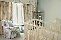 The twin boy's bedroom has a baby blue and cream colour scheme