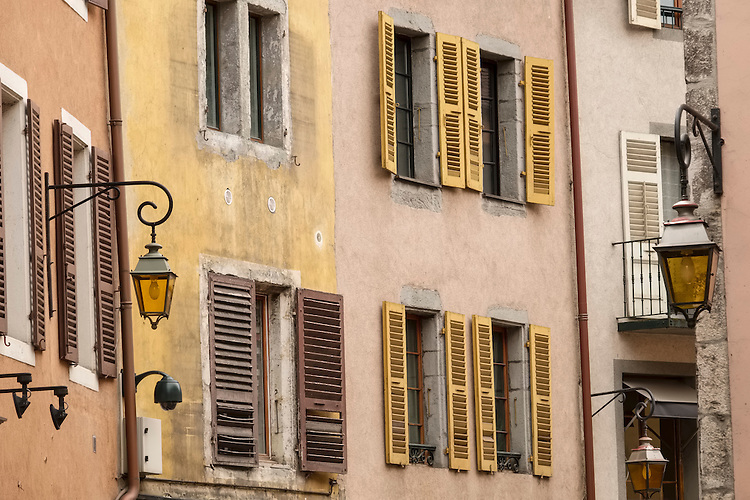 The narrow streets of Annecy flow under the watchful gaze of shuttered windows and iron street lights.