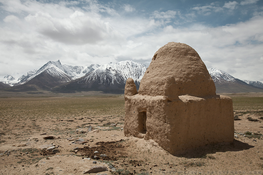 The dome shaped tomb of an old Kyrgyz tomb. ..Trekking through the high altitude plateau of the Little Pamir mountains (average 4200 meters) , where the Afghan Kyrgyz community live all year, on the borders of China, Tajikistan and Pakistan.