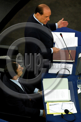 STRASBOURG - FRANCE -22 SEPTEMBER 2002 -- The Italian Prime Minister Silvio BERLUSCONI reporting to the EU-Parliament about the result of the EU-Summit of the 16-17.10.2003 with the Italian Minister of Foreign Affairs Franco FRATTINI at his side. -- PHOTO: JUHA ROININEN / EUP-IMAGES