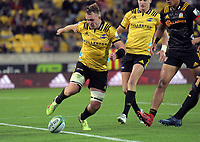 Hurricanes number eight Gareth Evans tries to keep the ball in play during the Super Rugby match between the Hurricanes and Chiefs at Westpac Stadium in Wellington, New Zealand on Friday, 13 April 2018. Photo: Dave Lintott / lintottphoto.co.nz