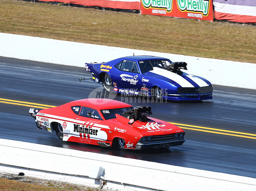 Mar 18, 2017; Gainesville , FL, USA; NHRA pro mod driver Doug Winters (near) races alongside Eric Latino during qualifying for the Gatornationals at Gainesville Raceway. Mandatory Credit: Mark J. Rebilas-USA TODAY Sports