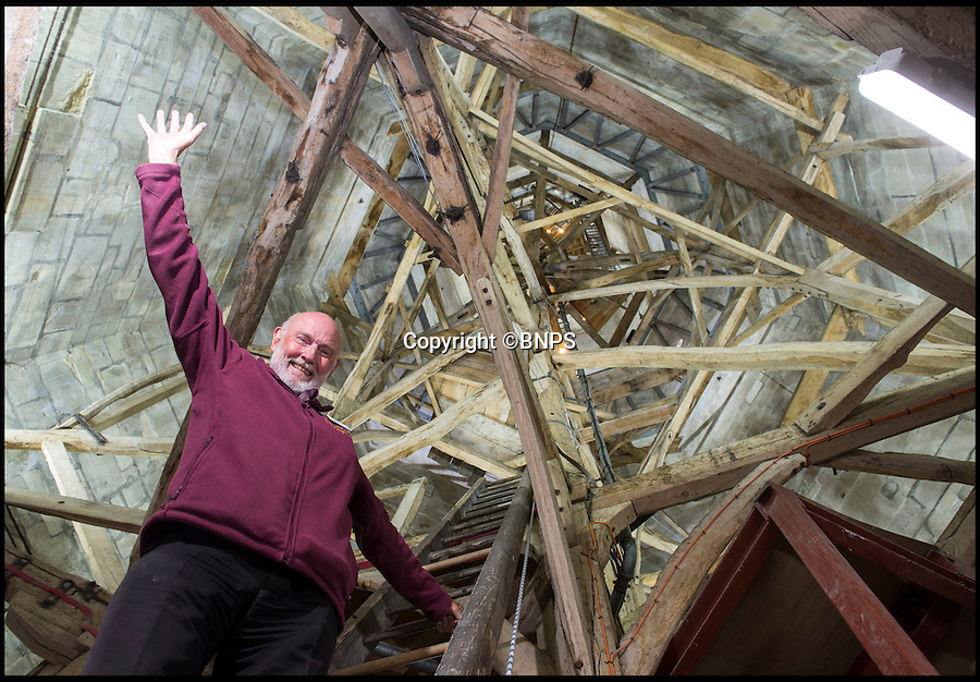BNPS.co.uk (01202 558833)<br /> Pic: PhilYeomans/BNPS<br /> <br /> Let there be light...generous volunteer reveals medieval marvel for the first time in its history.<br /> <br /> A dedicated cathedral tour guide has dipped in to his own pocket to pay for the installation of lights to illuminate the inside of Britain's tallest spire for the first ever time.<br /> <br /> Robert Stiby, 79, has been a lifelong admirer of Salisbury Cathedral in Wiltshire, but after spending the last eight years guiding visitors up the 330 steps to the spire he became frustrated by the lack of light to reveal its true glory.<br /> <br /> The full extent of its amazing medieval feat of engineering could barely be seen in the gloom, until Robert splashed out £5000 of his own money to install 24 LED lights to reveal the oak structure that holds up the final 180ft of its needle like spire.