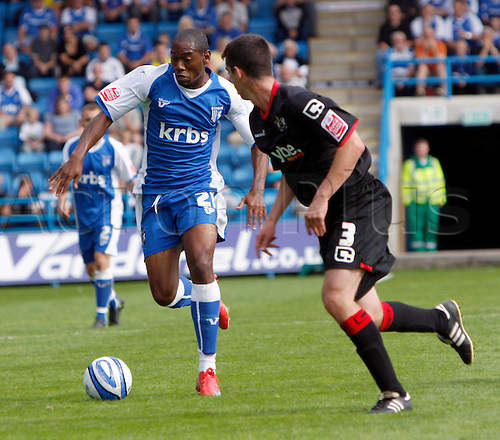 5th September 2009. Gillingham's Dennis Oli runs at the Exeter defence in the shape of Richard Duffy during the first half. Division 1 match - Gillingham v Exeter City at Priestfield Stadium, Gillingham, Kent, England.Photo: Colin Read/Actionplus.
