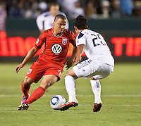 CARSON, CA – June 3, 2011: DC United forward Charlie Davies (9) attempts to move past LA Galaxy defender AJ DeLaGarza during the match between LA Galaxy and DC United at the Home Depot Center in Carson, California. Final score LA Galaxy 0, DC United 0.