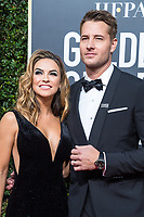 Chrishell Stause and Justin Hartley arrive at the 75th Annual Golden Globe Awards at the Beverly Hilton in Beverly Hills, CA on Sunday, January 7, 2018.<br /> *Editorial Use Only*<br /> CAP/PLF/HFPA<br /> &copy;HFPA/Capital Pictures