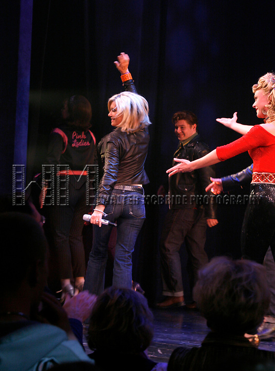 Olivia Newton-John is headed back to Rydell High to promote Breast Cancer Awareness after the Curtain Call for GREASE at the Brooks Atkinsoon Yheatre in New York City. <br />October 7, 2008<br />( pictured: Olivia Newton John, Ashley Spencer )