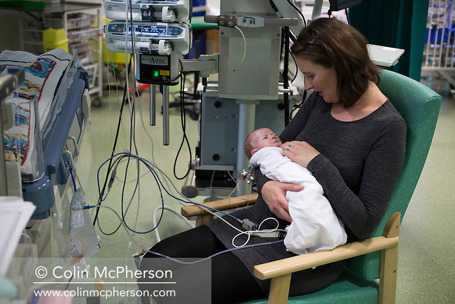 Kathryn Jones cradles her three-and-a-half-week-old son Finn at the paediatric intensive care unit at Evelina London Children's Hospital in central London. The son of Philip and Kathryn Jones from Canterbury, Kent, Finn was born with a pre-diagnosed condition which required a life-saving, five-hour heart 'switch' operation to be carried out within the first two weeks of his life. The operation, which took place when Finn was 10 days old was successful, however, due to other near fatal complications the his recovery during the subsequent six weeks was slow and difficult.