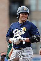 Infielder Dante Bichette, Jr. (19) of the Charleston RiverDogs smiles after getting a hit in a game against the Greenville Drive on Sunday, May 19, 2013, at Fluor Field at the West End in Greenville, South Carolina. Bichette Jr. is the No. 21 prospect for the New York Yankees, according to Baseball America. Charleston won, 9-7. (Tom Priddy/Four Seam Images)